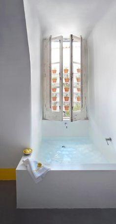 bathroom inspiration - built in tub under a window