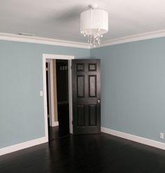 My style: dark floors, dark doors, white trim.