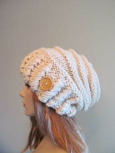 This is a hand made knitted oversized slouchy hat, or beanie with a button. Made of soft super chunky acrylic yarn in big bold stitching, in the White Cream color. This beanie is loose-fitted, thick and comfortable. Its a great accessory for winter, fall and spring. Thank you so much, please check out my other hats and berets: http://www.etsy.com/shop/Lacywork?section_id=11219415   Have a great day.