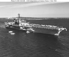 USS Independence (CVA-62) Crewmembers man the rail as the ship is visited by Prince Rainer and Princess Grace of Monaco, while anchored off Cannes, France, 5 July 1962. USS Compton (DD-705) is in the background. Official U.S. Navy Photograph.