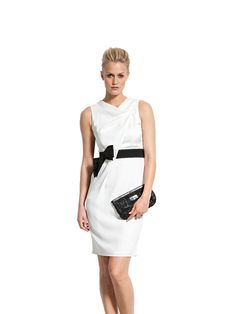 exclusive from designer brand Paule Ka. It is lovely made in pure white with a contrasting black ribbon belt with bow. This dress will have you looking confident a