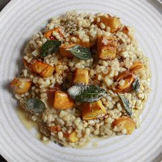 Butternut Squash Pearl Barley Risotto 500g of 1 inch butternut squash 2 banana shallots, finely chopped 1 garlic clove A few sage leaves, a couple shredded and few left whole 100ml white wine 1 litre chicken or vegetable stock 300g pearl barley 50g butter Salt and pepper Olive oil