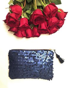 Elektra clutch.  Add a bit of sparkle and whimsy to your next special occasion, or simply look effortless stylish while you are sipping your Chardonnay, watching a beautiful California sunset.  - Handmade item. - Matte-finish sequins. - Brass zipper with blue tassel detail - Fully lined.  7,5 wide x 4.5 tall  This item is Handmade with love, under a sunny California sky. All the materials are hand picked at the local shops and/or from fellow Etsy sellers.  ©2016 The Resort Collection. All…