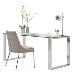 Le bureau NEVADA en verre est doté de pieds en acier chromé pour un style ultra contemporain.