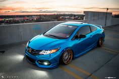 Take a look at the Chrome Blue Stanced Honda Civic Si Coupe by Avant Garde photos and go back to customizing your vehicle with renewed passion. 2006 Honda Civic Si, Honda Civic Si Coupe, Honda Civic Vtec, Civic Jdm, Civic Coupe, Car Colors, Car Show, Custom Cars, Subaru
