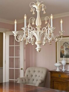 room decor with elegand hand-carved wood chandelier in antique white finish; chandeliers; wood chandeliers; dining room lighting ideas