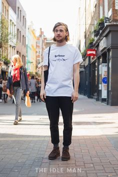 Clean and Simple   A simple stylish look, wear a white logo tee with a pair of cropped black trousers. Finish with some wallabee shoes or a pair of kicks of your choice.   Shop men's clothing at The Idle Man