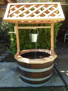 Garden Wishing Well with Water Feature. $185.00, via Etsy.