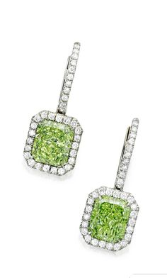 Pair of Fancy Yellow-Green Diamond and Diamond Earrings. Set with two cut-cornered rectangular modified brilliant-cut Fancy Yellow-Green diamonds weighing 2.54 and 2.43 carats, framed and suspended by round diamonds.