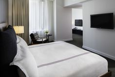CHECKING INN | Our Alcove studio, with clean crisp interiors and a very comfortable bed.
