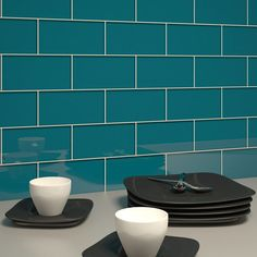 <p>Our dark teal style subway glass tiles are a highly unusual and eye-catching color and will certainly serve as a focal point for any renovation that you should carry out within your home. If you're tiling your kitchen backsplash these tiles will defini