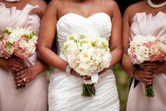 light pink gowns with clutch bouquets of pink hydrangea, sahara roses, and freesia wrapped in black satin | by Dorothy McDaniel's Flower Market, Elle Danielle Photography