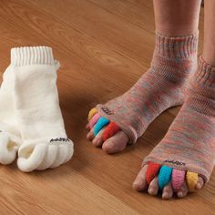 Happy Feet Socks...Think of them as antidotes to high heels, sport strain, and everyday foot stress. Simply by aligning your toes into the proper position, these socks prevent and relieve many common foot problems: bunion pain, plantar fasciitis, hammer toes, and everyday tired feet. Wear them while relaxing at home, or sleep in them and wake up feeling great. I need these!!