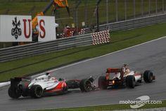 JENSON BUTTON, MCLAREN MERCEDES AND NARAIN KARTHIKEYAN, HRT FORMULA ONE TEAM MAKE CONTACT Lewis Hamilton, Malaysia 2012 2012 Formula 1 Malaysian Grand Prix.  #motorsport #f1 #automotive #formula #one #race #car #lemans #btcc #le #mans #auto #art #mcqueen #steve  http://www.thegalleryofspeed.com/ #2012 #wrc #motorsport #formulaone