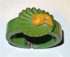 A delightful vintage fish and seashell clamper bracelet.