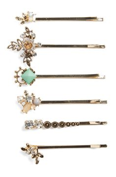 Striking, vintage-inspired embellishments elevate these stylish bobby pins that elegantly accent any updo.