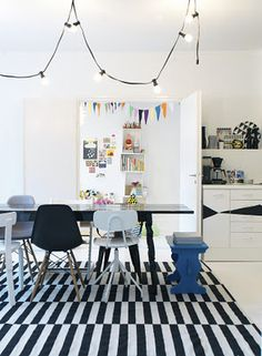 IKEA Stockholm Rand rug, eclectic, bunting, string of lights, black dining table, blue bench seat Eames Chairs, Dining Chairs, Dining Table, Dining Room, Dining Area, Lounge Chairs, Interior Inspiration, Room Inspiration, Design Inspiration