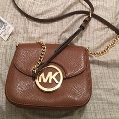 8b6680a6077859 Michael Kors Crossbody Luggage Brown Michael Kors Crossbody bag small. NWT.  Will sell for