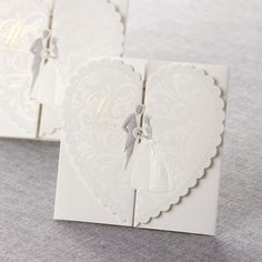 This romantic gatefold modern invitation features delicately embossed bride and groom inside a laser trmmed heart. Gold foil stamping accentuates the look. The insert allows extra space for special wording or messages.