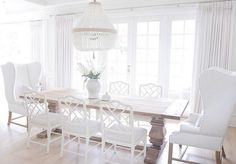 The side chairs are Dayna Chairs in Rubbed Cream from Ballard Designs.