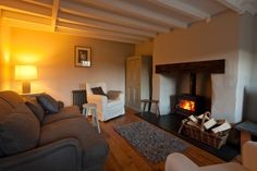 The cosy, rustic sitting room of a Welsh holiday bolthole. See http://www.sheepskinlife.com