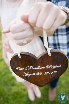 harford county engagement photo, spring outdoor engagement photo, cherry blossom engagement photo, romantic light bright engagement photo, save the date wooden heart sign, our story begins