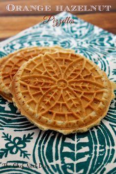 "Orange Hazelnut Pizzelles: The Chef Next Door - these ""cookie"" confections are addictive, nice to find a recipe. Pizzelle Cookies, Waffle Cookies, Cookies Et Biscuits, Bar Cookies, Cookie Desserts, Cookie Recipes, Dessert Recipes, Cookie Flavors, Italian Cookies"
