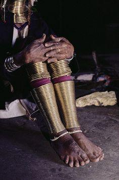 Burma | Padaung Woman with Copper Rings on Legs. Loikaw | © Robert van der Hilst