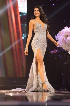 """Kristal Silva represented Mexico well at this year's Miss Universe pageant. She made the judges fall in love with her in this dazzling silver evening gown!  The Color  This color may not have a """"pop,"""" but the more understated color palette complements Kristal's bronzed complexion and lustrous dark hair.  The crystal detailing shines beautifully under the stage lighting."""