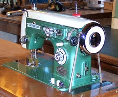"""This Universal de luxe Super Zigzag was made in Japan in the mid 1960s. It's so pretty with all of it's dials, buttons, and levers, and it's gorgeous two-tone color scheme. We thought it was the ideal machine for the first of our """"Awesome Treadles"""" line."""