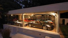 Bueller? Bueller? A Ferris Bueller style glass garage filled with exotic cars. See more at the site.