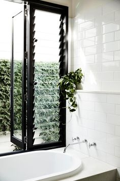 7 lessons learned from an inner-city renovation Louvred windows and fans circulate air efficiently throughout the house. Bathroom Windows, Bathroom Interior, Bathroom With Window, Bath Window, Louvre Windows, Traditional Bathroom, Window Design, Windows And Doors, Home Windows