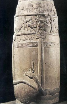 This unfinished and uninscribed boundary stone (kudurru) is a symbol of the cosmos as conceived by the Kassites: a giant, two-homed snake (symbolizing the river of the underworld) encircles the foundations of an earthly palace, the towers and battlements of which rise upon its back; above them, a procession of minor deities play instruments and are accompanied by wild beasts; the next tier, marked by the emblems of the supreme deities, is heaven.