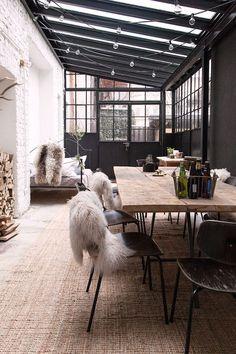 exposed white brick wall in black framed sunroom. / sfgirlbybay