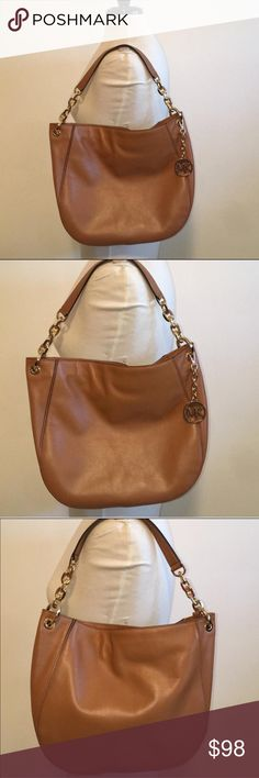 "Real and Gorgeous Michael Kors bag. Gorgeous Michael Kors bag, with inside code AI-1609, Camel soft leather, Camel leather and gold chain shoulder strap, beige MK monogram inside, gold hardware. 12"" X 15"" X 3"" Looks in good condition, no tears, clean, only a pen mark close to the zipper. Please read the description well, So I do not have to get any returns. -No holds.  -No trades. -No more discounts for this bag, It is not easy to find good prices for reselling. Click the listings to see the…"