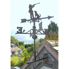 Wonderfully classical, this Iron Game Season Weathervane is unique in design and is a delightful addition to your home, farm or estate. The weathervane is made in cast iron and is finished in a wonderfully rustic brown. Weather Vain, Floral Umbrellas, Cast Iron, It Cast, House Roof, Door Knockers, Cherub, Rooster