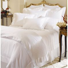 SFERRA Giza 45 percale bed linens is the finest, lightest, and most breathable fabric that you will ever find. SFERRA Giza 45 percale sheeting is pristine, finished with SFERRA's classic hemstitch. Giza bed linens made in Italy. World's Finest Sheets. Grande Hotel, Luxury Bedding Collections, Bed Sets, Fine Linens, King Duvet, Queen Duvet, White Bedding, Flat Sheets, Fitted Sheets