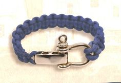 Marine Paracord Rope Bracelet. Ready to wear on multiple wrists. Weighs about 2 ounces. Unique design not only provides you with extra paracord and hardware for emergencies, but is easily adjustable to three different wrist sizes. Color: navy blue paracord. Stainless steel shackle and hasp. Great nautical gifts, and stocking stuffers, for many ages.