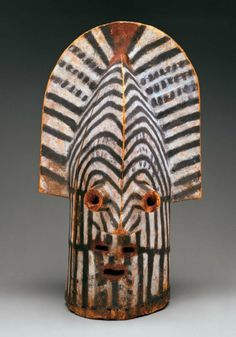 Africa | Helmet mask ~ kifwebe ~ from the Tempe-Songye people of DR Congo | Late 19th to early 20th century | Wood and paint