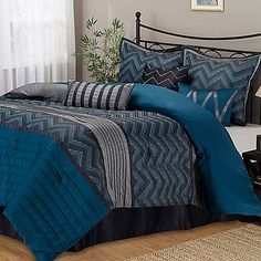 Full of bold, rich colors and a visually dynamic design, the Chevron comforter set is the perfect way to update your bedroom's décor in style. It has a woven chevron design in blues and greys with pieced bands of blue and silver with pintucking details.