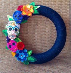 Hand embroidered felt skulls and flowers decorate this colorful and festive 12 inch yarn wrapped wreath. Perfect for Halloween, Día de Muertos celebrations or even all year round. Halloween Home Decor, Halloween House, Fall Halloween, Halloween Crafts, Holiday Crafts, Halloween Decorations, Halloween Stuff, Vintage Halloween, Halloween Makeup