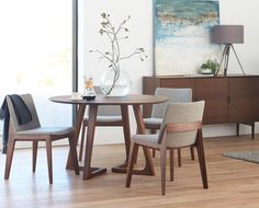 Scandinavian Designs - The Cress round dining table will nurture your inner perfectionist with its equal focus on angles and curves. The unique angled legs of this solid American walnut table balance beautifully against the beveled circular tabletop. Scandinavian Dining Table, Modern Dining Chairs, Dining Table Chairs, Scandinavian Modern, Scandinavian Furniture, Comfortable Dining Chairs, Dining Nook, Dining Room Sets, Dining Room Design