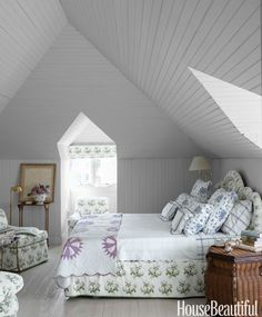 A coat of soft white paint enhances the open feel in this breezy bedroom.