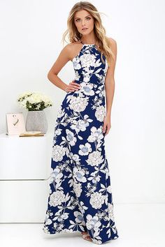 All the honeybees agree, the In Blossom Blue Floral Print Maxi Dress is where it's at this season! Dark blue woven fabric is adorned in an ivory, light pink, and light blue botanical print, beginning at a halter bodice with button closure and open back. Princess-seamed bodice meets a fitted waist and full maxi skirt. Hidden back zipper and clasp.