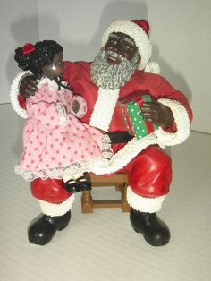 blackafrican american christmas santa claus wchild on lap with box cute