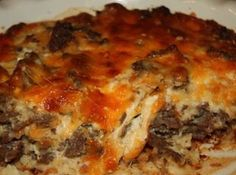 Cheeseburger In Paradise Casserole Recipe  	1 lb lean ground beef 1 large onion (chopped) 1/2 teaspoon of seasoned salt 1/2 teaspoon of garlic powder a dash or worcester sauce 1 cup of shredded cheddar cheese (I used 3/4 cheddar and 1/4 mozzarella) 1 cup of milk 1/2 cup of Original Bisquick mix 2 eggs