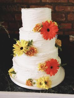 Whipped buttercream wedding cake with gerber daisies from NashvilleSweets.com