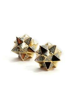 p> This  pair of geometric stud earrings rendered in 18k yellow gold feature intricate pyramid shapes that are accented with white diamonds.   Please note: This item is final sale.