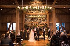 Gorgeous rustic ceremony backdrop at Devil's Thumb Ranch