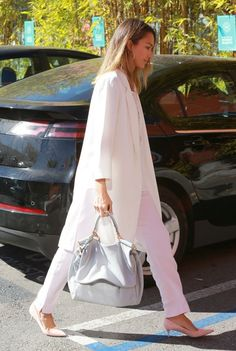 """Actress Jessica Alba heads to her Honest Company office on March 13, 2015 in Los Angeles, California. The """"Sin City"""" star recently returned from Dubai where she was promoting the new Braun beauty line."""